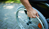 In rolstoel na arbeidsongeval